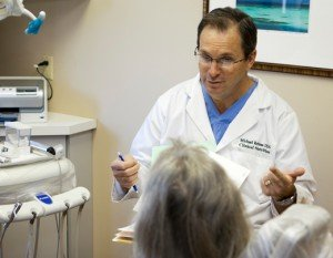 Dr. Rehme talking with a patient
