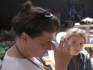 woman smoking near child