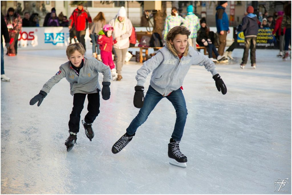 two boys ice skating