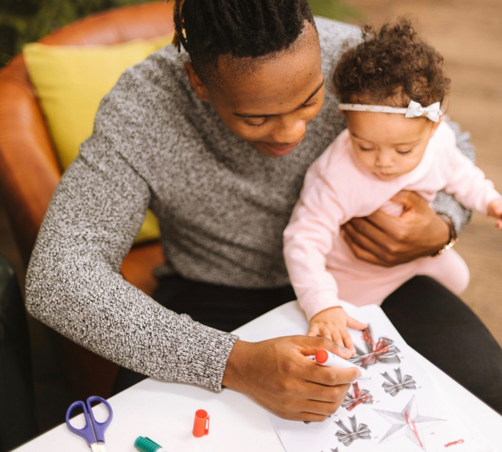 man coloring with child
