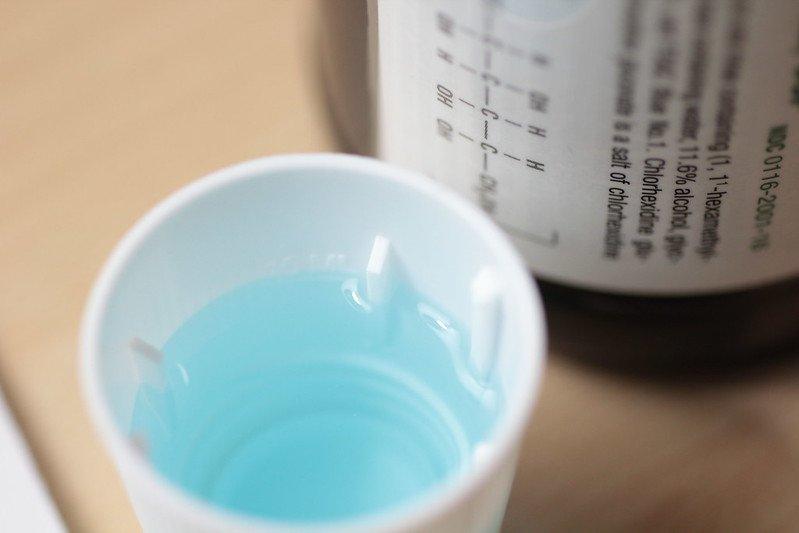capful of chlorhexidine rinse