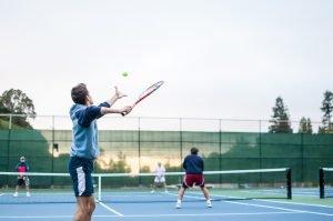 4 men playing tennis