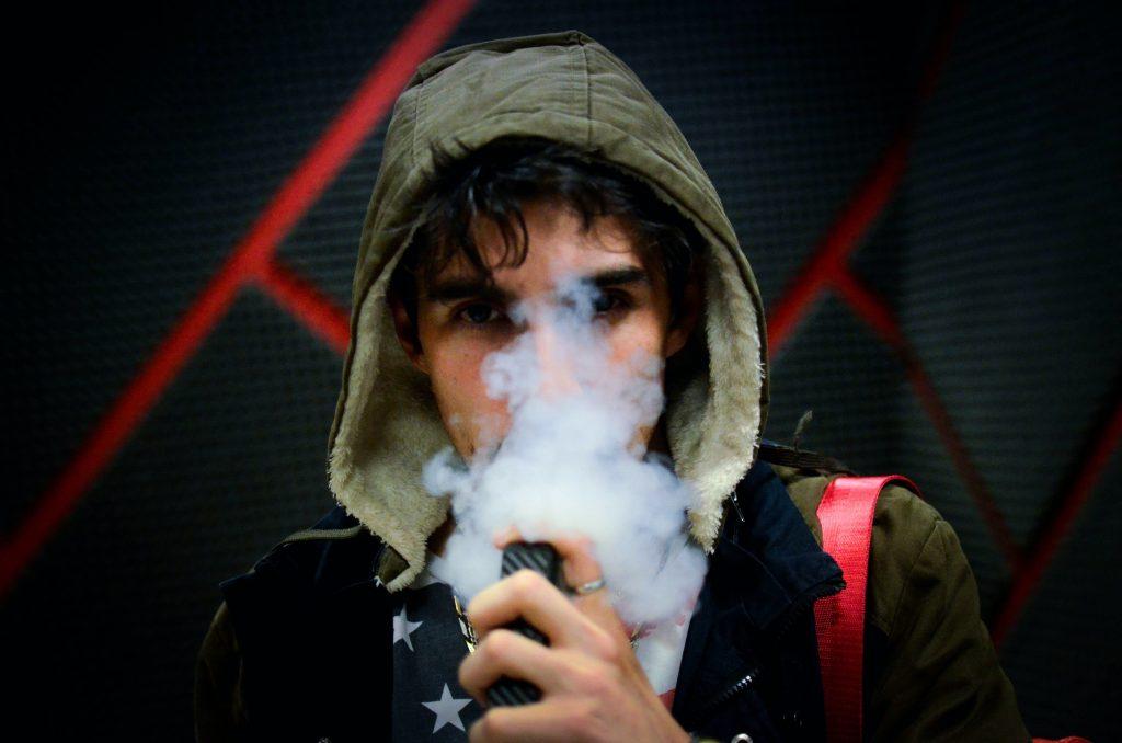 Young man using a vape