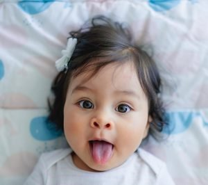 child with tongue sticking out