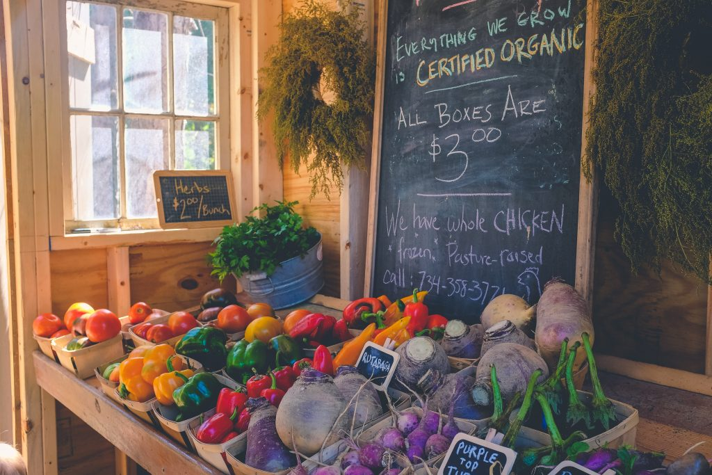 picture of a certified organic farm stand with a sign for pasture-raised chickens