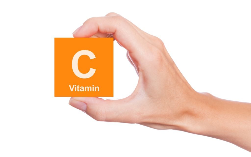 hand holding square that says vitamin C